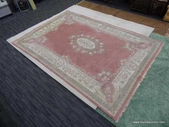 HAND KNOTTED RUG; PINK AND CREAM HAND KNOTTED RUG WITH BLUE, GREEN, AND ROSE COLORED FLOWERS. HAS