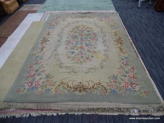 HAND KNOTTED AREA RUG; FLAT WEAVE SAGE GREEN AND TAN RUG WITH PINK, RED, AND BLUE FLOWERS. MEASURES
