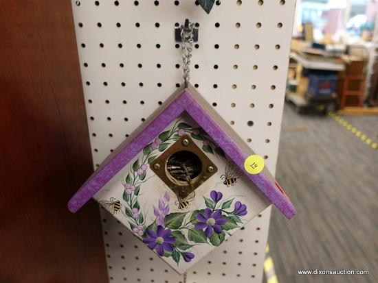 (R1) BIRDHOUSE; HAND PAINTED WOODEN BIRD HOUSE WITH AN OPENING BOTTOM LATCH. MEASURES 9 IN X 6 IN X