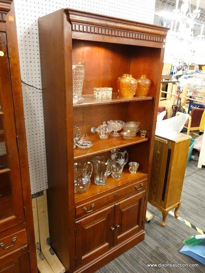 (R1) WOODEN DISPLAY CABINET; WOOD GRAIN DISPLAY CABINET WITH DENTAL MOLDING SITTING ABOVE A OPEN