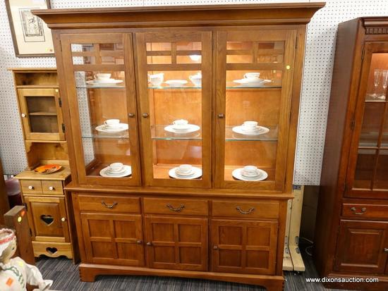 (R1) CHINA CABINET; 2 PIECE CHINA CABINET. TOP PIECE HAS 3 FRONT GLASS DOORS THAT OPEN TO REVEAL 2