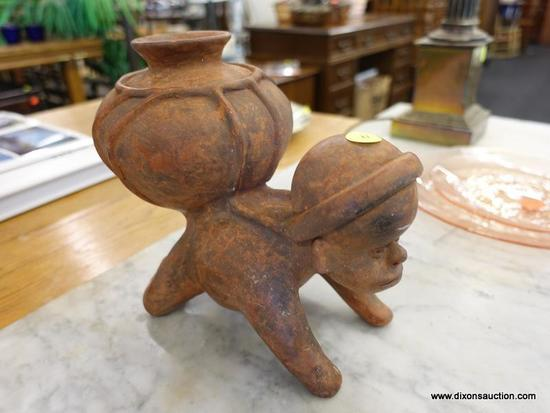 (R1) POTTERY ART FLOWER POT; SHOWS A MAN A MAN ON ALL 4'S WITH A LARGE JAR STRAPPED TO HIS BACK THAT