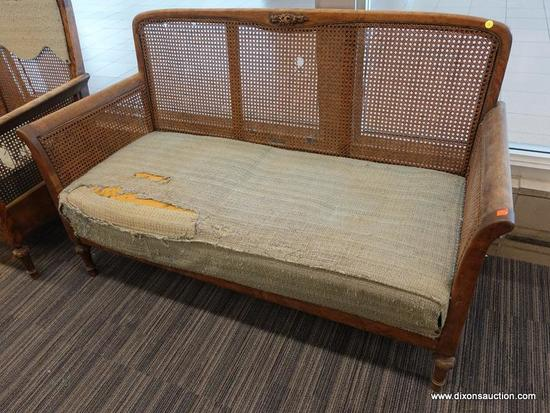 (DOOR) WICKER LOVESEAT; WOODEN LOVESEAT WITH A WICKER LACED BACK AND SIDES AND ROLL ARMS. HAS A