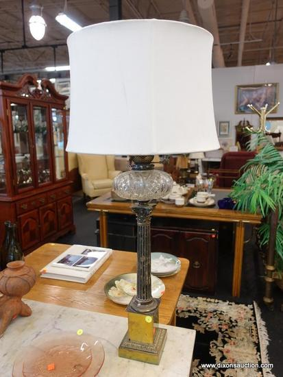 (R1) TABLE LAMP; VINTAGE OIL LAMP CONVERTED TO ELECTRIC WITH A COLUMN SHAPED STEM SITTING ON A GOLD