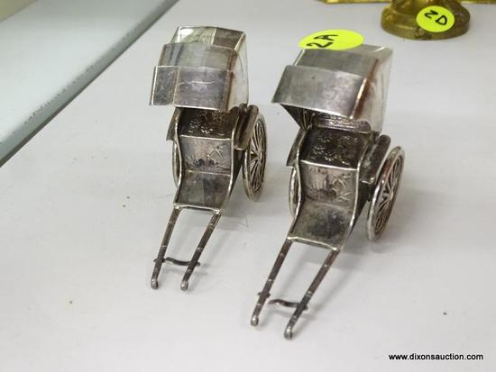 (SHOW) PAIR OF STERLING SILVER RICKSHAWS; UNIQUE SALT AND PEPPER STERLING SILVER RICKSHAWS WITH