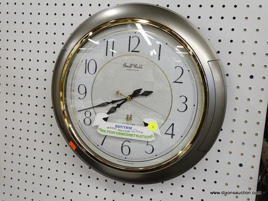 (WALL) SMALL WORLD RHYTHM CLOCK; SMALL WORLD HOURLY SOUND RHYTHM MAGIC MOTION CLOCK WITH A GOLD TONE
