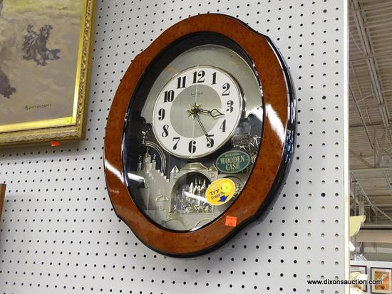 (WALL) SMALL WORLD RHYTHM CLOCK; SMALL WORLD RHYTHM CLOCK IN AN OVAL WOODEN CASE, MADE IN JAPAN. HAS