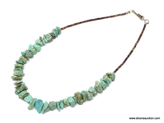 TURQUOISE NECKLACE; SMALL STONE TURQUOISE NECKLACE WITH SMALL BROWN BEADS. HAS A HOOK CLOSURE. 15 IN