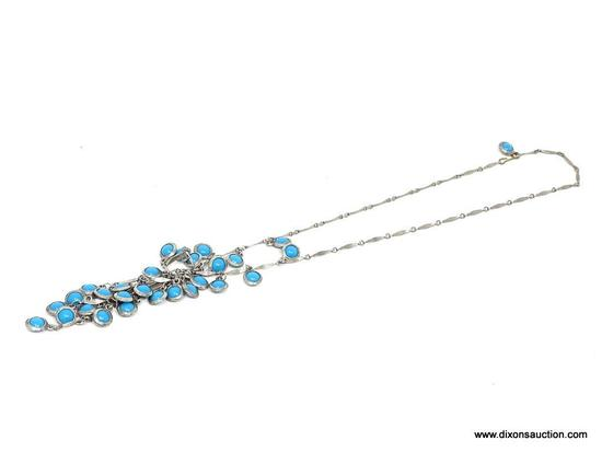 TURQUOISE NECKLACE; MULTI-STRAND SILVER TONE NECKLACE WITH MOUNTED TURQUOISE STONES HANGING FROM THE