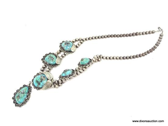 STERLING SILVER AND TURQUOISE NECKLACE; HANDMADE SQUASH BLOSSOM SILVER AND TURQUOISE NECKLACE WITH