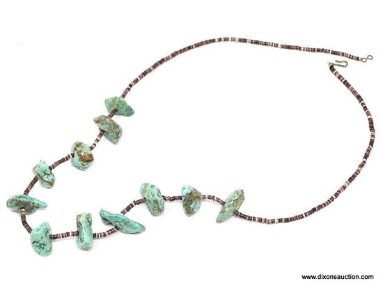 TURQUOISE AND PUKA SHELL NECKLACE; MEDIUM SIZE TURQUOISE STONES SEPARATED BY SMALL DARK PUKA SHELLS.