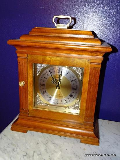 (LR) MANTEL CLOCK; CHERRY CASED STRASBOURG MANOR QUARTZ CLOCK WITH WESTMINISTER CHIMES-12 IN X 6 IN