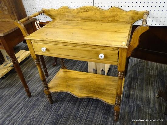 (R1) POPLAR WASHSTAND; HAS DOUBLE TOWEL BAR AND A BACKSPLASH. HAS A SINGLE DOVETAIL DRAWER WITH