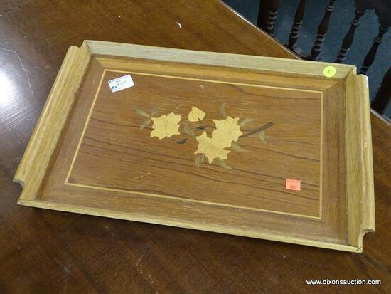 (R1) INLAID WOOD TRAY; HAS INLAID FLORAL CENTER AND TWO SCROLLING HANDLES. MEASURES 12.5 IN X 19.5