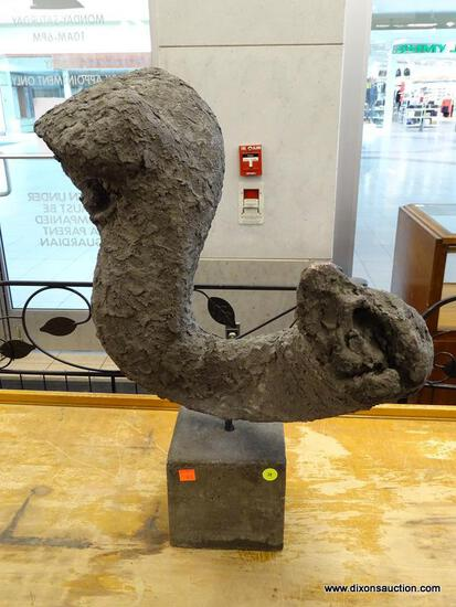 (R1) CEMENT TRUNK-SHAPED SCULPTURE; WITH GREY PLASTER STYLE FINISH. SITS ON CUBIC BASE. MEASURES ~18