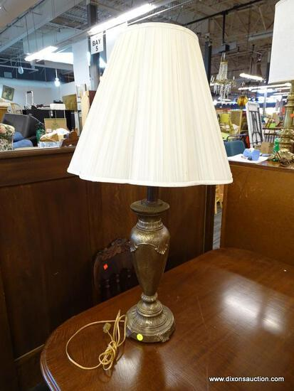 (R1) METAL URN SHAPED HAMMERED STYLE TABLE LAMP; COMES WITH SCALLOPED RIM COOLIE SHADE. MEASURES 34