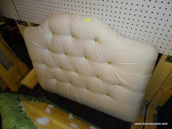 (R1) TWIN SIZE HEADBOARD; HAS WHITE UPHOLSTERY AND BUTTON TUFTED WITH GREEN BUTTONS. TWIN SIZE