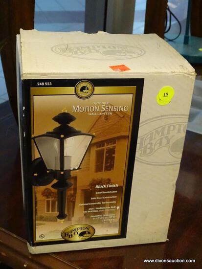 (WINDOW) HAMPTON BAY OUTDOOR, MOTION SENSING WALL LANTERN; COMES WITH A BLACK FINISH AND CLEAR