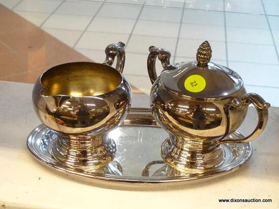 (WINDOW) SILVERPLATE CREAMER AND PITCHER SET; COMES WITH UNDERPLATE AND SCROLL DETAILED HANDLES.