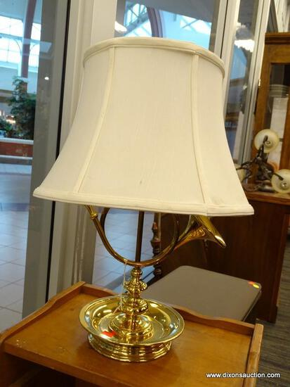 (WINDOW) FRENCH HORN TABLE LAMP; BRASS TABLE LAMP WITH A SAUCER SHAPED BASE AND A TURNED POLE STEM