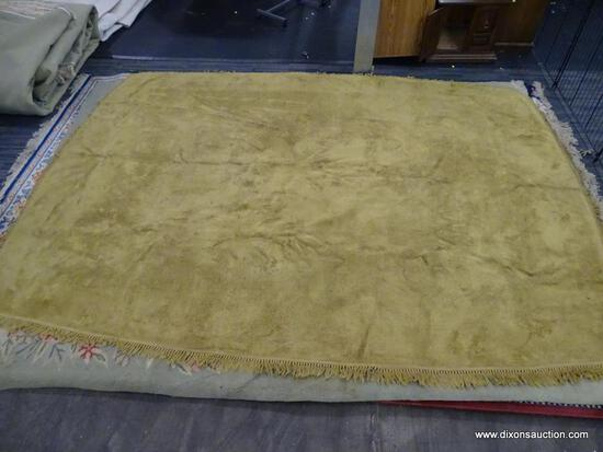 ROUNDED CORNER AREA RUG; MUSTARD YELLOW, MACHINE WOVEN AREA RUG WITH FRINGS ALL AROUND THE RUG.
