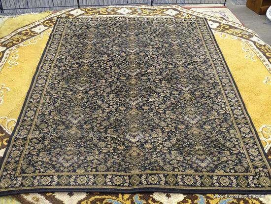 STANTON RUG COMPANY AREA RUG; WOOL AREA RUG WITH A MIDNIGHT COLOR AND A FLORAL PATTERN. HAS BEIGE