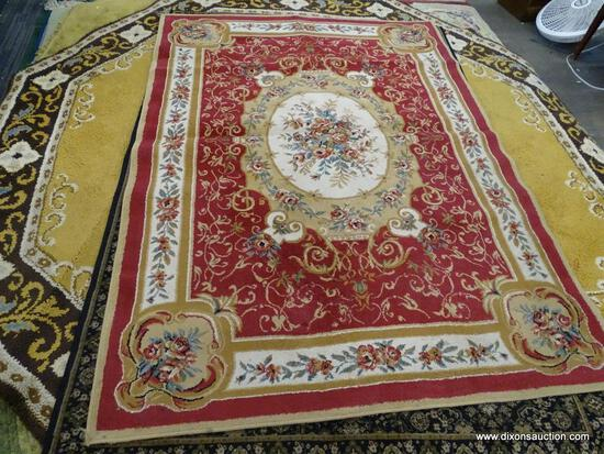 ROYALTY AREA RUG; WOOL PILE AREA RUG WITH A FLORAL PATTERN AND A RED WITH BEIGE COLOR. MEASURES 5 FT