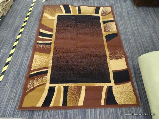 ARIANA MACHINE WOVEN AREA RUG; AZTEC LIKE AREA RUG WITH BLACK, BROWN, AND MAROON COLORS. MEASURES 4