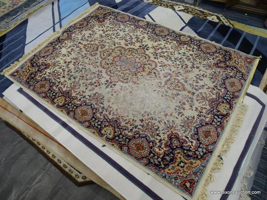 FLORAL AREA RUG; HAS A CREAM, ORANGE, NAVY, AND LIGHT BLUE COLORED GEOMETRIC FLORAL PATTERN. HAS