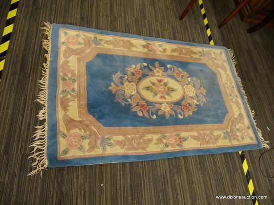 PASTEL SMALL AREA RUG; MACHINE WOVEN, WOOL PILE AREA RUG WITH A PINK, BEIGE, AND BLUE COLOR. HAS
