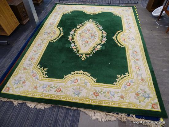 ORIENTAL AREA RUG; GREEN, YELLOW, AND CREAM ORIENTAL AREA RUG WITH YELLOW, BLUE AND RED FLOWERS. HAS