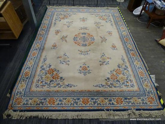 KARASTAN AREA RUG; CHINESE MEDALLION #718 AREA RUG WITH A BEIGE, ORANGE, AND BLUE COLOR. HAS FRINGES