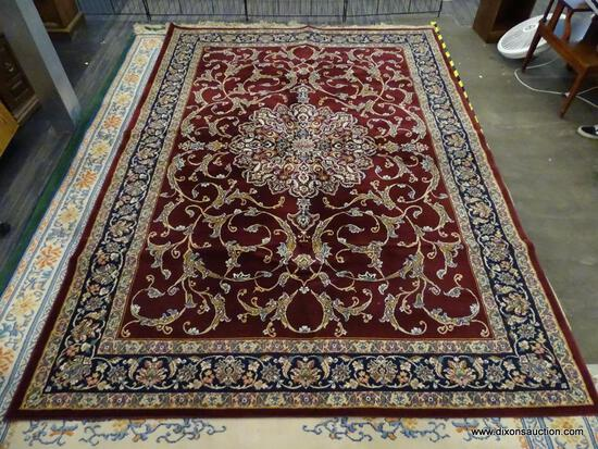 IMPERIAL AREA RUG; HEIRLOOM FLORAL PATTERNED AREA RUG WITH A WINE AND NAVY COLOR. MEASURES 7 FT 8 IN