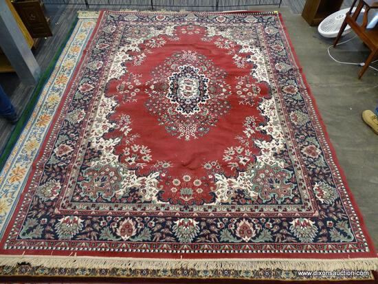 FLORAL AREA RUG; RED, CREAM, NAVY, AND GREEN FLORAL AND LEAF PATTERNED, MACHINE WOVEN AREA RUG WITH
