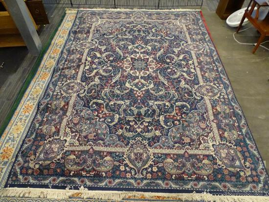 DALYN RUG COMPANY AREA RUG; CLASSICAL LEAVES AREA RUG WITH A NAVY COLOR. HAS FLORAL AND LEAF
