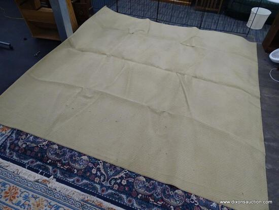 LIGHT BROWN AREA RUG; SOLID COLOR AREA RUG WITH A WOVEN LIKE PATTERN. MEASURES 124 IN X 124 IN.