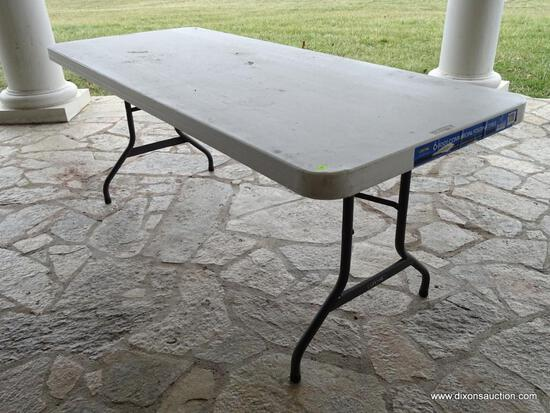 "(OUT) LIFETIME 6' TABLE; WHITE PLASTIC TOP TABLE WITH GREY METAL FOLDING LEGS. MEASURES 6' X 2' 6"" X"