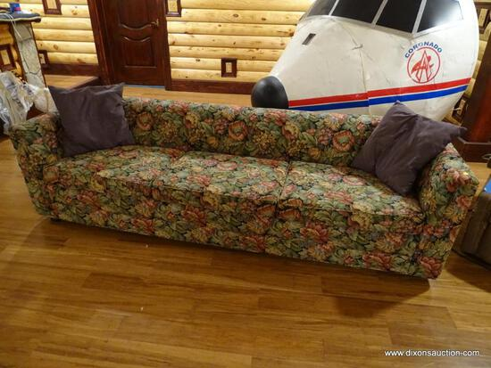 (BDEN) VINTAGE FLORAL UPHOLSTERED THREE CUSHION SOFA; SHORT ROLLED BACK & SIDES. DOES HAVE SOME WEAR