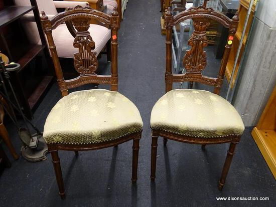 (WINDOW) PAIR OF PIERCED SPLAT CHAIRS; TWO ELEGANT CHAIRS WITH A FLOWER PATTERNED, GOLD TONED