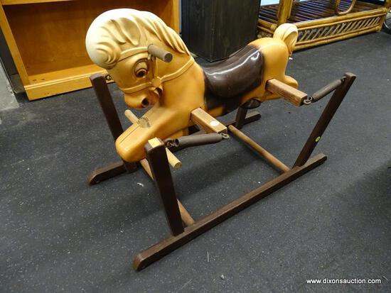 (WINDOW) THE WONDER PONY RIDING HORSE; MEASURES 14 IN X 29.75 IN. IN AVERAGE CONDITION.