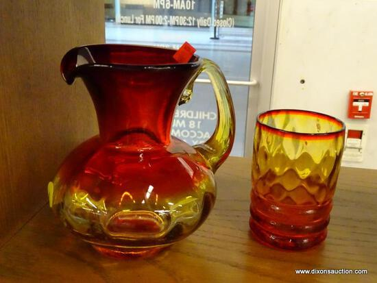 (R1) CUP AND PITCHER; HAND BLOWN CARNIVAL GLASS CUP AND PITCHER WITH RED AND AMBER TINT.