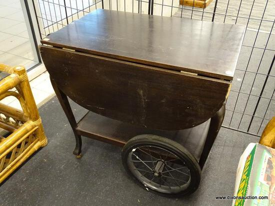 (WINDOW) DROP LEAF TEA CART; DROP LEAF WOODEN TEA CART WITH DARK FINISH, HAS 9.75 IN LEAVES, METAL