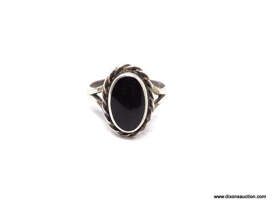 LADIES STERLING SILVER AND ONYX RING; BLACK ONYX OVAL SHAPED CENTER STONE ON A STERLING SILVER BAND.