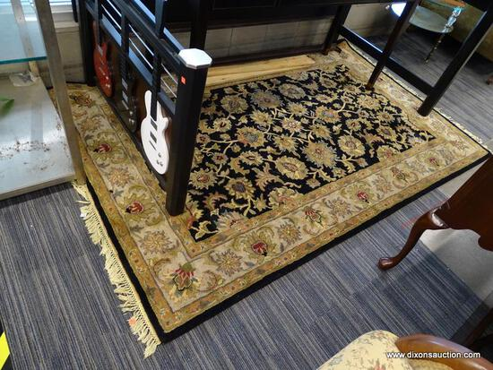 (WINDOW) RUGS USA WOOL PILE RUG; HAND TUFTED, BLACK AND BEIGE RUG WITH A FLORAL PATTERN. HAS FRINGES