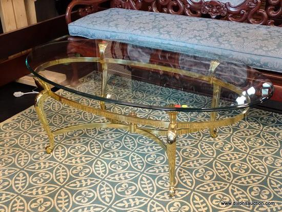 "(R1) OVAL COFFEE TABLE; GLASS TOP, OVAL COFFEE TABLE WITH A POLISHED BRASS BASE. MEASURES 49"" X"