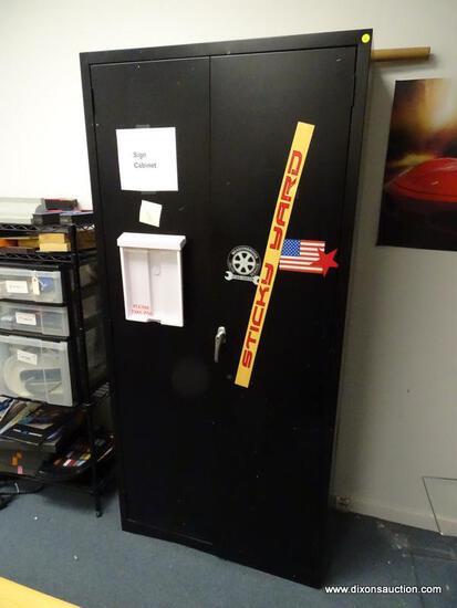 (OFC2) BLACK TWO DOOR METAL STORAGE CABINET WITH 2 METAL SHELVES. TWISTING LATCH HANDLES. MEASURES