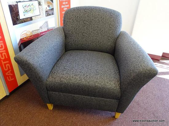 (OFC1) MCM STYLE GREY UPHOLSTERED ARM CHAIRS WITH BLACK PATTERN AND TAPERED NATURAL WOOD GRAIN FEET.