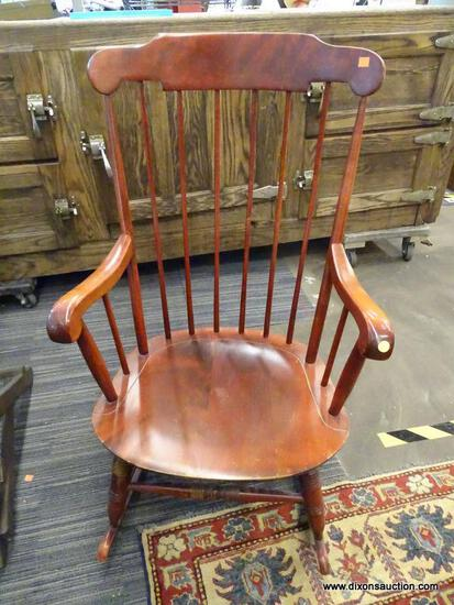 (R1) WINDSOR STYLE ROCKER; CHERRY FINISHED WINDSOR STYLE ROCKER WITH ROLLING ARMS, TURNED LEGS AND A