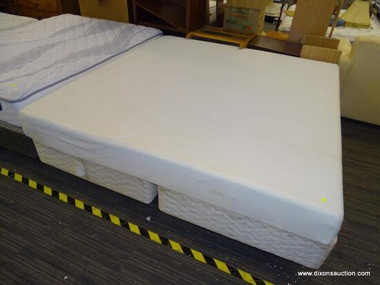 CAL KING FOAM MATTRESS WITH SPLIT BOX SPRING AND METAL BED FRAME.