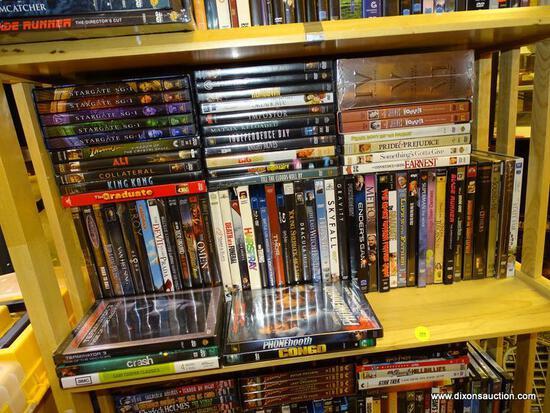 (R2) SHELF LOT OF DVDS; LOT INCLUDES 5 VOLUMES OF STARGATE SG-1, SKYFALL, TITANIC, BLADE RUNNER,